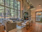 Main living area with roaring gas fire - gorgeous wraparound views of National Forest!