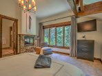 Master Suite #1 with king bed, forest views, privacy, fireplace, sitting area, and en-suite bathroom