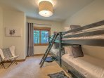 Fun bunk room sleeps 6 in style - twin trundle under each bed.  Full bath right across the hall.