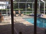 Screend pool (w/swim jets) and attached jaccuzi tub. Solar and heat pump heat