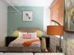 Queen alcove bedroom behind living area