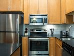 Fully equipped kitchen stocked with everything you need