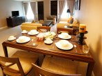 Dinning table set with 4 chairs next to the living room area