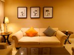 Night scene of big couch with a beautiful lamp in the living room
