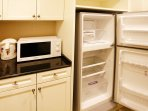 Spacious fridge freezer, microwave, and electric kettle