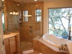 master bath and shower with views of lake