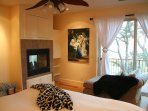 Master bedroom with views of lake and fireplace!