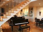Baby Grand Piano in between living, dinning and kitchen areas