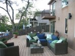 expansive deck with outdoor sofa and dining table, bbq