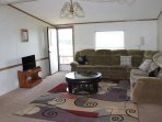 Living room with a fold out sectional & 2 recliners with massage feature