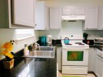 Equipped with coffee maker, ice bucket, microwave, toaster oven, blender and basic cooking tools