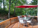 Step out of the kitchen/dining area onto the front deck. Charcoal grill included.