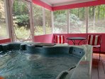 Relax in the hot tub and enjoy the privacy of the screened in deck. Seats 5