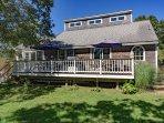 Large Deck runs full length of house