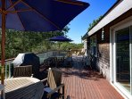 Large deck runs full width of house, overlooks private yard