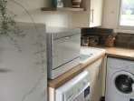 Fridge freezer, dishwasher, washing machine and tumble dryer. Also has large oven,hob and microwave