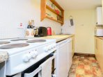 Compact kitchen but with everything you need including a dishwasher.