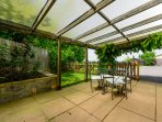 Private Patio overlooking the garden and field.s  South facing.