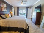 Master Bedroom with sliding glass doors onto the pool area
