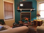 Living space w/flat screen tv, wood burning fireplace. Wood provided. Relax after exploring Santa Fe