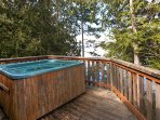 The private deck features a delightful hot tub and BBQ