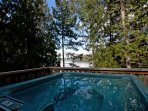 Lounge in the private outdoor hot tub surrounded by the forest and ocean setting