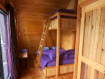 The second bedroom provides a double bed and single bunk