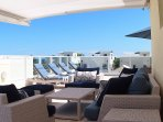Lounge in sun or shade on roof-top deck, complete with own pool and ocean views!