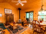 Upper living room with wood burning stove, tv & satellite