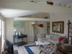 Open plan living room, with high beams, stylish decor of Ile de Re.