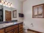 The second bathroom (2) again features granite countertops, an extra long counter with vanity and oversized walk-in...