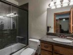 The third bathroom (3) features granite countertops, vanity with bronze finishes and combination shower with bathtub.