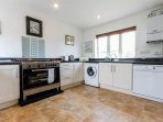 Kitchen with large gas cooker.