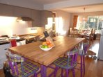 Kitchen island with dining room in background