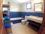Main bathroom, bath, shower, toilet, bidet, sink and lots of towels
