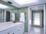 Luxury master bedroom full bath with multi-head fixture.
