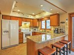 The expansive kitchen with granite countertops provides everything you'll need to whip up scrumptious homemade meals.