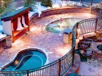 Heated concrete melts the snow around the hot tubs and on the walkways