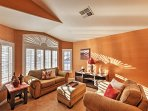 The sun peeks through into the spacious living room to help you  feel at home.