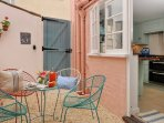 French doors lead out from the dining room into a suntrap courtyard.