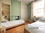 The guest bedroom has 2 small singles made of solid oak wood frame and superior quality linen.