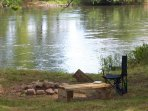 Enjoy a fire in the firepit while listening to the river flowing past, just feet away!