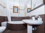 Upstairs main bathroom with bath