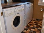 Full laundry room with washer and dryer.