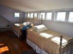 Third floor family suite twin beds.