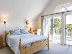 2nd Level Mater Bedroom en suite. TV, private Juliet Balcony
