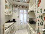 Kitchen equipped with all main utensils and appliances. Washing machine and dishwasher.