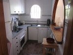 Kitchen with dishwasher, electric stove and oven, toaster, coffee machine, juice press etc