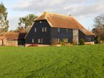 Traditional Sussex barn in extensive private grounds