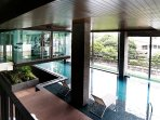 Panoramic pool and fitness views over a balcony in a bedroom